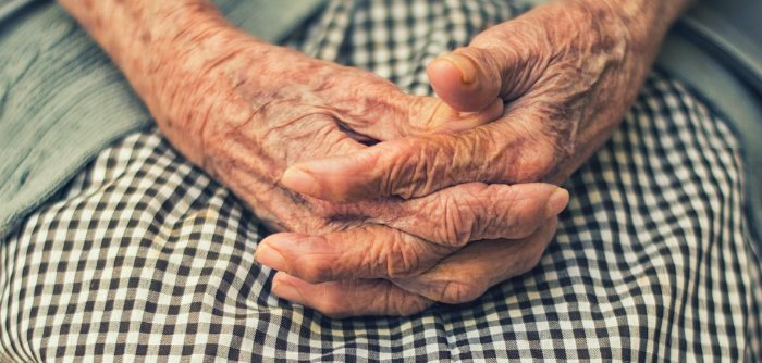 An elderly woman's hands resting on a weighted blanket to help with dementia. Image: Photo by Christian Newman via unsplash.com.
