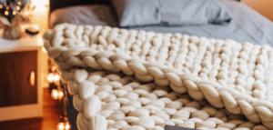 Chunky knit blanket. Image courtesy of Brittney Weng via unsplash.com.