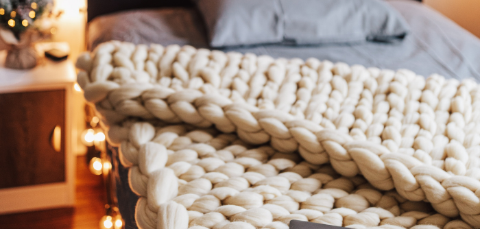 A chunky knit weighted blanket. Photo: Brittney Weng, via unsplash.com.